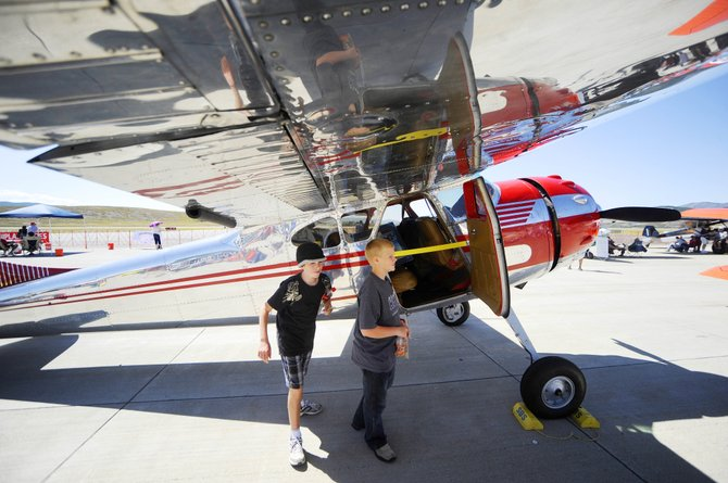 Steamboat Springs' Andrew Matthews, right, and Cole Morgan look at a 1951 Cessna during the 2012 Wild West Air Fest at Steamboat Springs Airport. The event will take place this year from 9 a.m. to 3 p.m. Saturday and Sunday.
