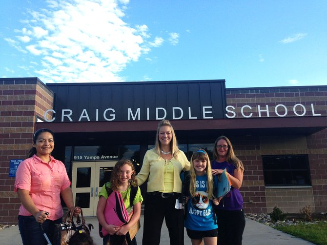 Parent Veronica Ramirez, sixth-grader Tali Lewis, Craig Middle School Vice Principal Jill Hafey, sixth-grader Ashley Lemoine and parent Julie Fisher congregate on the first day of school Monday morning.