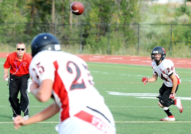 Steamboat Springs coach Lonn Clementson looks in on a passing drill as Jimmy Weltzheimer tracks a pass from Joe Deline. The Sailors begin their season Friday night with a 7 p.m. game against Eagle Valley.