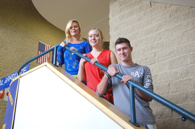 From left, Moffat County High School juniors Jo-el Cole, Treann Quick and Calden Scranton head down the stairs following the first day of classes at MCHS. The school implemented a new block schedule this year.