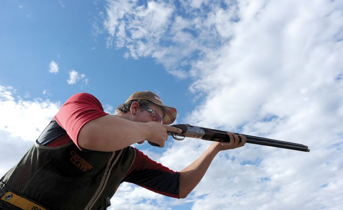 Logan Bankard takes aim Monday evening at the Routt County Rifle Club while practicing for this weekend's state shooting championships.