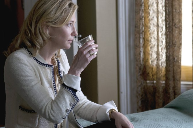 "Jasmine (Cate Banchett) takes a drink and takes a hard look at her life in ""Blue Jasmine."" The movie is about a woman who is forced to move in with her sister after her wealthy husband is revealed to have cheated investors out of millions."