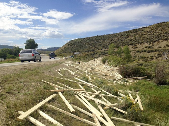 Two-by-fours littered U.S. Highway 40 on Friday after a semitrailer lost control while going around a corner about 14 miles west of Kremmling.
