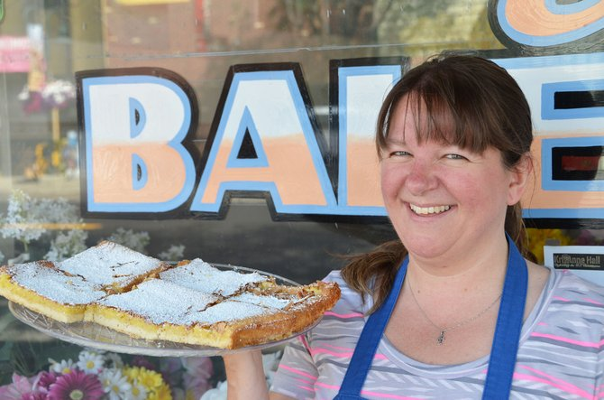 Kandee Dilldine holds a plate full of lemon bars outside her bakery, KS Creations on Yampa Avenue. Dilldine enjoys volunteering for the Taste of Home Cooking School each year it visits Craig.