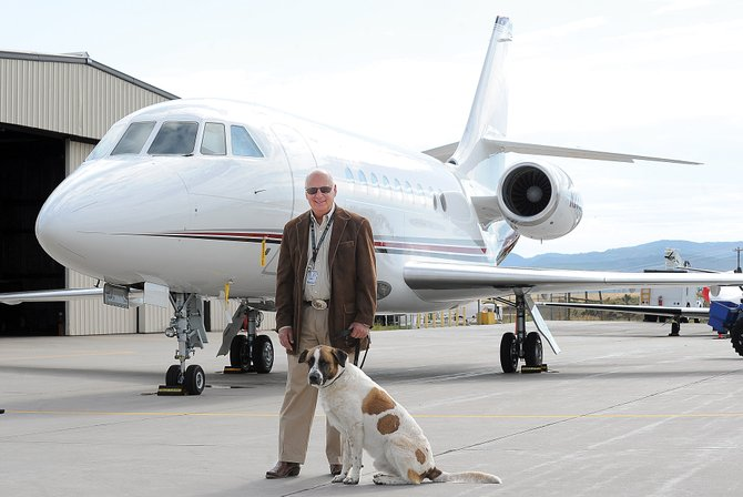 Don Kaplan, regional manager for Galaxy Avation and pictured with his dog Tsar, says his operations have seen an  increase in the number of jets flying in and out of the Yampa Valley Regional Airport.