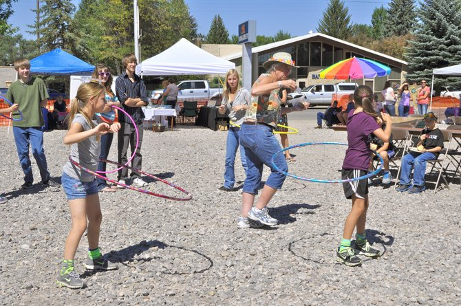 Beth Gilchrist oversees the hula hoop contest during last year's Art'n the Park'n Lot. The Northwest Colorado Chapter of Parrotheads event, scheduled for Saturday, will offer numerous activities, live music and vendors selling arts and crafts.