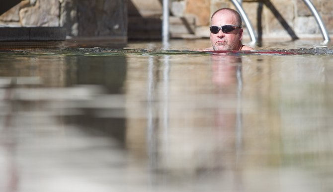 Stacy Toye takes advantage of Tuesday's warm weather to soak at the Old Town Hot Springs.