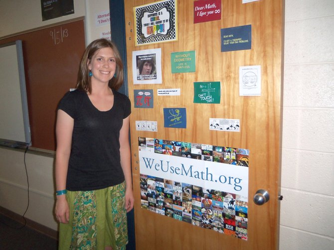 Moffat County High School math teacher Kristin Ingalls stands by her classroom door, full of math-themed  bits of humor, at the end of the school day Thursday. Ingalls, Paula Duzik and Brynna Vogt are among the 12 regional nominees for Educator of the Year through Peabody Energy Leaders in Education, an award which will be given out Saturday night at The Steamboat Grand.