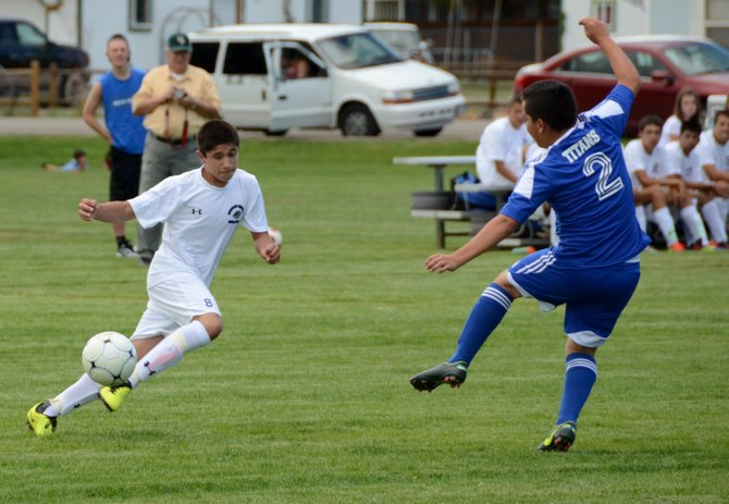 Ulysses Silva fakes out a defender during a Moffat County home game against Coal Ridge earlier this season. The Bulldogs traveled to Rifle on Tuesday and lost, 3-1. They now are 0-3 this season.