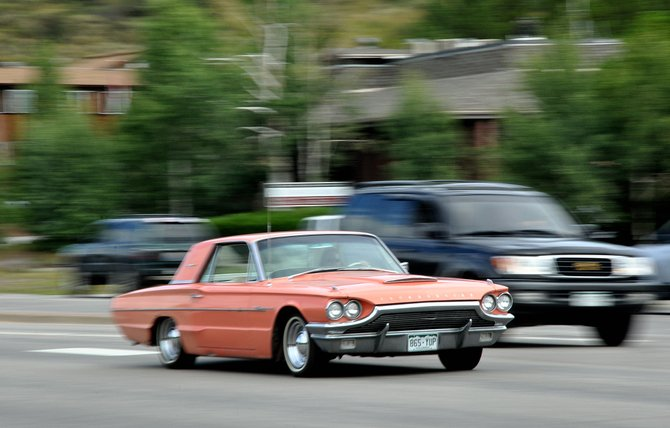 A Thunderbird cruises down U.S. Highway 40 near Hilltop Parkway in Steamboat Springs. The Colorado Department of Transportation is researching the feasibility of Colorado drivers paying for every mile they drive instead of a gas tax at the pump.