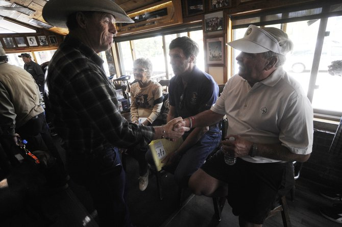 Steamboat Springs resident Dean Smith visits with former Tugboat Grill & Pub owners Hank Edwards, right, and Larry Lamb.