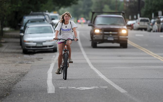Breyanna Waldsmith rides her bike along Yampa Street in downtown Steamboat Springs on Wednesday afternoon. A new bike counter on the street detected an average of 606 bike trips daily from June 20 to Tuesday.