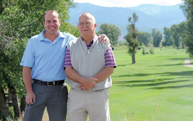 Steamboat Golf Club General Manager Wayne Garrison, right, and current shop assistant Seann Conway pose for a photograph overlooking the golf course. Garrison is retiring at the end of the summer, and Conway has been selected to fill his position next year.