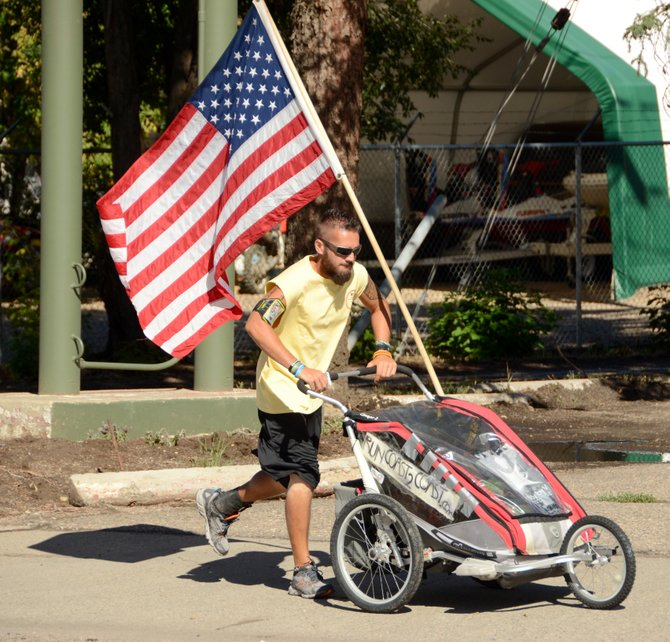 Noah Coughlan heads east on Victory Way, pushing his stroller with running gear, food and supplies. Coughlan is running across the country from San Francisco to Boston to raise awareness for Batten disease. He was in Craig on Day 48 of his run, which he hopes to finish in early November. If he finishes, he will become the 27th person to cross the U.S. on foot twice.