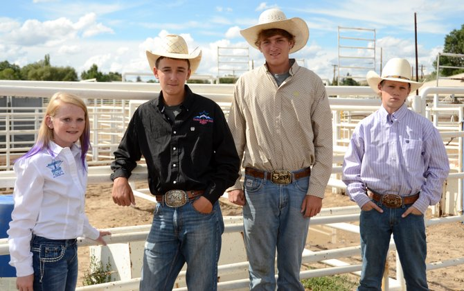 Members of the Moffat County junior high and high school rodeo teams pose at the Moffat County Fairgrounds. Jaidyn Steele (seventh grade), Dusty Taylor (10th grade), Denton Taylor (11th grade) and Garrett Uptain (10th grade) are just four members of a stacked group of Moffat County cowboys and cowgirls who plan on bringing home several more buckles from the state and national rodeos in the coming year.