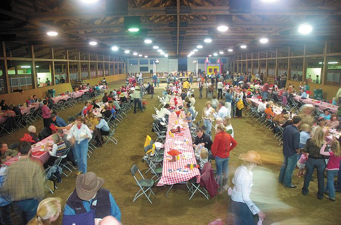 The 2009 Community Barbecue and Barn Dance brought a colorful crowd to the horse arena at Sidney Peak Ranch. This year's event starts at 5 p.m. Saturday at Wandering Creek Ranch and will raise funds for the Boys & Girls Club of Steamboat Springs and other Rotary Club charities.