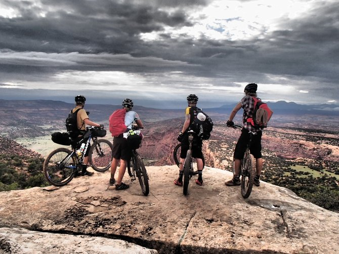 Pete Kraska, from left, Sarah Westendorf, Nate Bird and Pete Owen enjoy the high-altitude scenery along the 215-mile mountain bike trail from Durango to Moab, Utah.