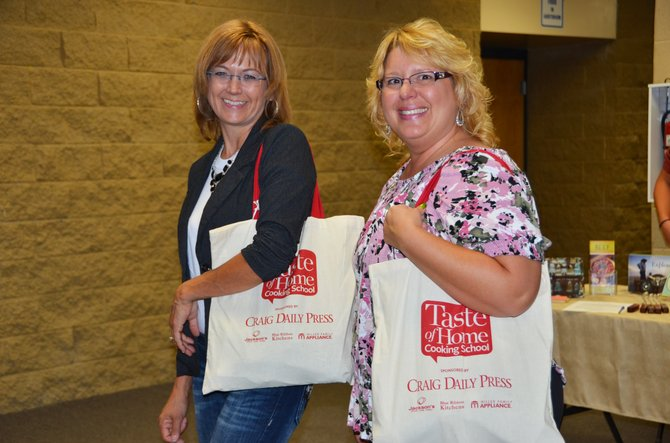 Elisa Wilson, left, and Melody Gingrich cheerfully enjoy their time at the Taste of Home Cooking School on Monday night. The event was a huge success, catered with tasty recipes and fun entertainment.