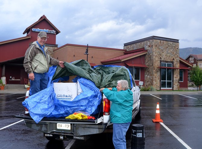 Gary and Carol Burkholder were preparing to leave Steamboat Springs on Thursday morning for Timberline Church in Fort Collins with a load of flood relief supplies including diapers, baby formula, bottled water, clothing and backpacks. Steamboat residents had all day Wednesday to bring supplies to the parking lot of Centennial Bank in Wildhorse Marketplace where a larger shipping container awaits.