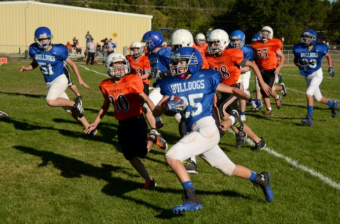 Thomas Baker, an eighth-grader at Craig Middle School, runs around the end against Hayden on Thursday at the CMS football field. Baker returned a kick for a touchdown, and the seventh- and eighth-grade teams from CMS beat Hayden, 46-24.