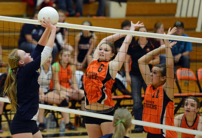 Hayden's Olivia Zehner, left, and Chancey Graham brace for a block Thursday against Vail Christian. The Tigers lost in three games, snapping what had been a three-match winning streak.