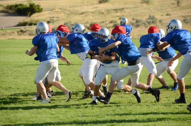 Joe Camilletti, pictured center during a Bulldogs practice, ran for an 80-yard touchdown in the fourth quarter Friday night at Delta, but it was the only score of the game for the Moffat County football team. The Bulldogs lost, 53-7.