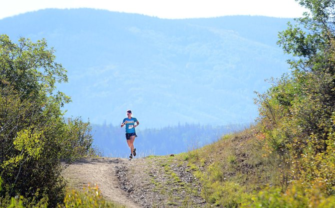 Heather Gollnick comes over a crest Saturday morning during the Emerald Mountain Trail Run in Steamboat Springs. The event was the final race of the summer's Steamboat Springs Running Series. Gollnick won the day's race and the overall season points championship in the series.