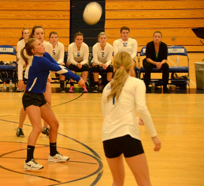 Jazmine Swindler, in blue, puts a Roaring Fork serve into play Tuesday at Moffat County High School. Swindler and the Bulldogs lost to the visiting Rams in four sets, 19-25, 19-25, 25-23, 18-25.