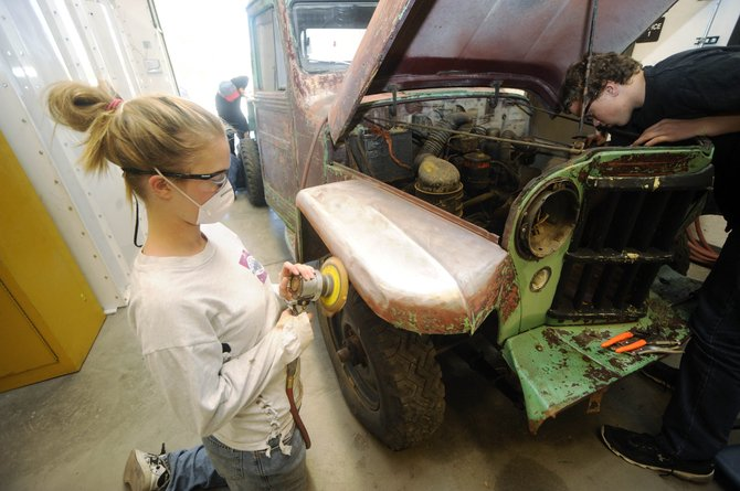 Hayden High School freshman Lexy Gumm sands an old Jeep during auto body class Tuesday. The school has received a $25,000 grant to offer an auto body class to all students in Routt and Moffat counties.