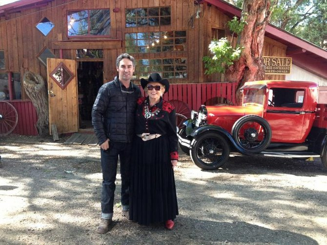 """American Pickers"" star Mike Wolfe stands with Cookie Lockhart in September at Lockhart Auction on 12th Street."
