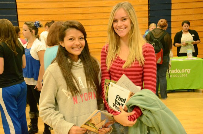 Moffat County High School sophomore Angelica Bernal, left, and freshman Pearl Wyman gather college information from schools like University of Northern Colorado and University of Colorado-Boulder, among others, at Wednesday morning's College Fair. Students received information from multiple schools, within Colorado and beyond.