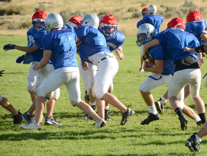 The Moffat County football team wants to swarm Eagle Valley's running attack, as they did here in practice at MCHS. The Bulldogs (0-4) host the Devils (3-1) at 7 p.m. Friday in Craig.