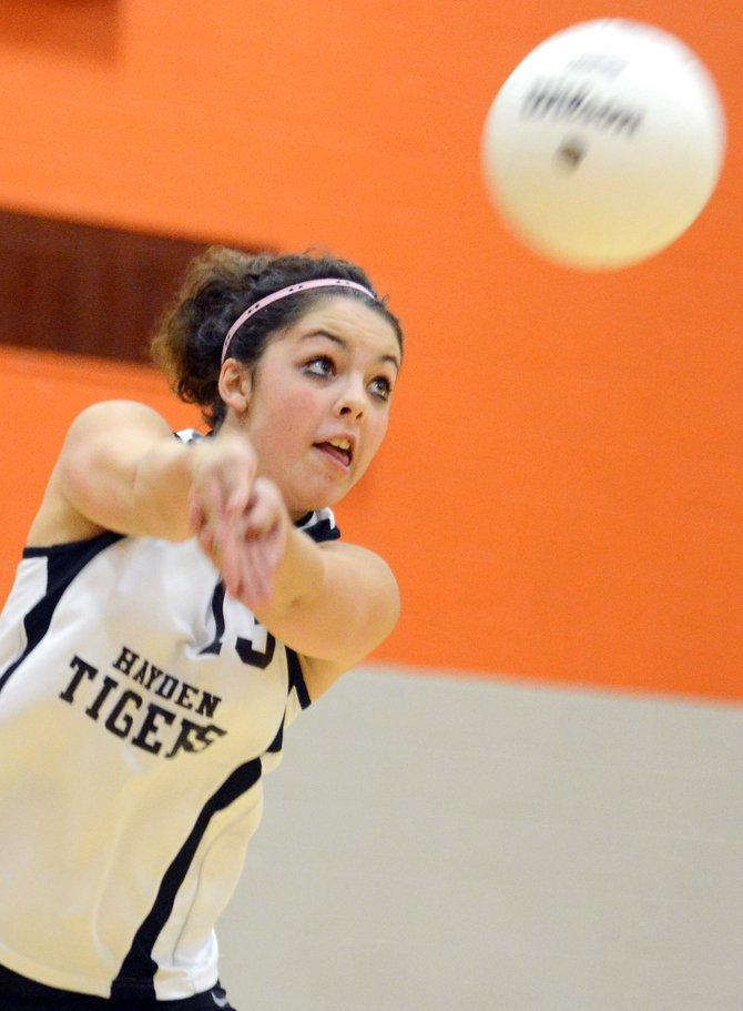 Hayden senior Belle Mazzola returns a ball Thursday as the Tigers ran by North Park to win for the seventh time this season. Hayden won in three easy sets, setting up a big game Saturday at home against Rangely.