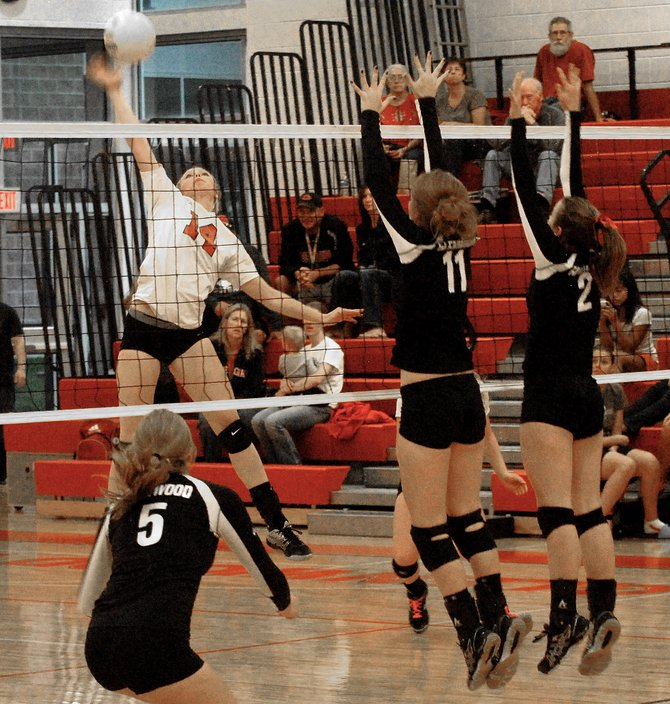 Steamboat Springs High School senior Mikaila Jegtvig, left, spikes the ball against Glenwood Springs High School seniors Laura McDermott, center, and Delaney Gaddis in Thursday's match in Glenwood Springs. The Sailors fell in three sets.