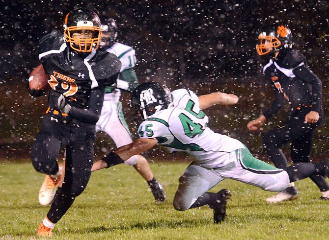 Hayden's Jack Redmond runs the ball Friday night. The Tigers lost to Rangely in a cold, wet game, falling by just a point, 15-14.
