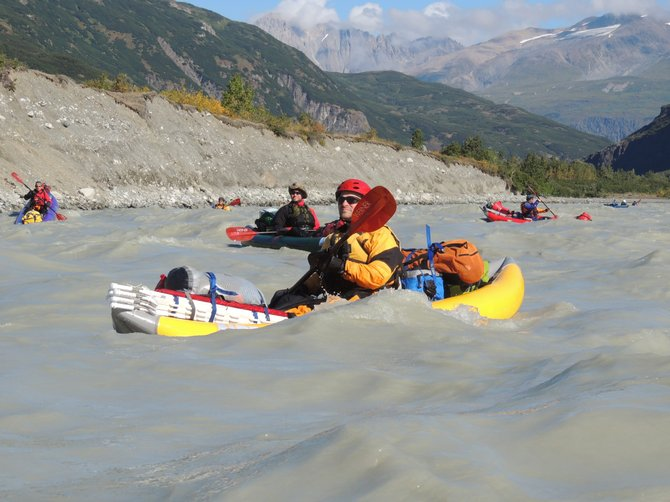 The team making its way downriver through the largest coastal mountain range in the world. The Alsek's flow would grow to more than 130,000 cubic feet per second by trip's end, more than 10 times the typical release flowing through the Grand Canyon.