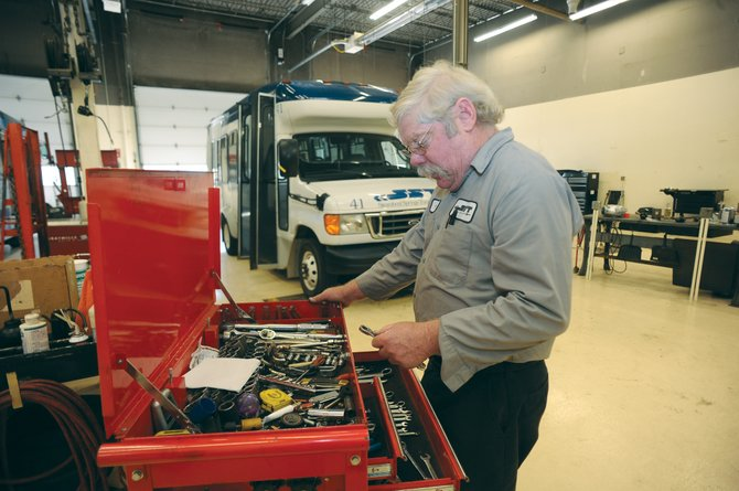 City of Steamboat Springs bus mechanic Thomas Zurstadt looks for the right tool while working on the electrical system of a bus Tuesday at the transportation center. The Steamboat Springs City Council is weighing a pay raise plan that aims to bring the salaries of several city employees up to a market rate determined by a salary survey.
