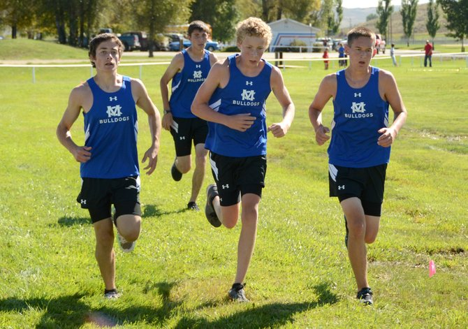 The Moffat County boys cross-country team has embraced pack running this season and has a shot at qualifying for the state meet in a couple of weeks. It will need strong races from every member, including Andrew Keiss, from left, Remmy Kohpay, Riley Allen and Isaac Chacon.