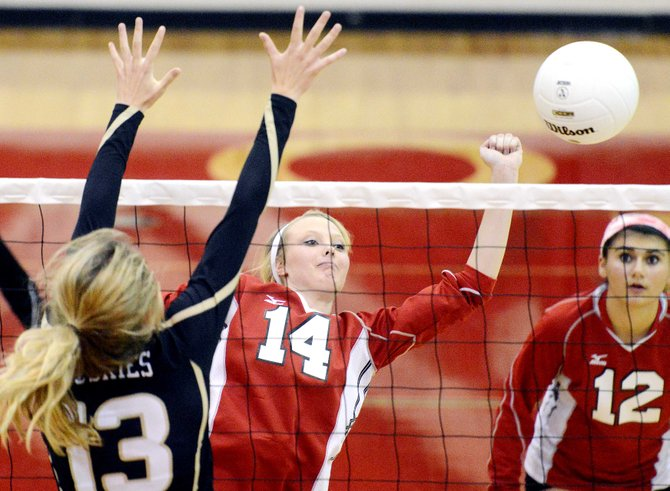 Steamboat's Mikaila Jegtvig swings for a ball late in Tuesday's match against Battle Mountain. The Sailors were at their best late but couldn't avoid a sweep at the hands of the league-leading Huskies.