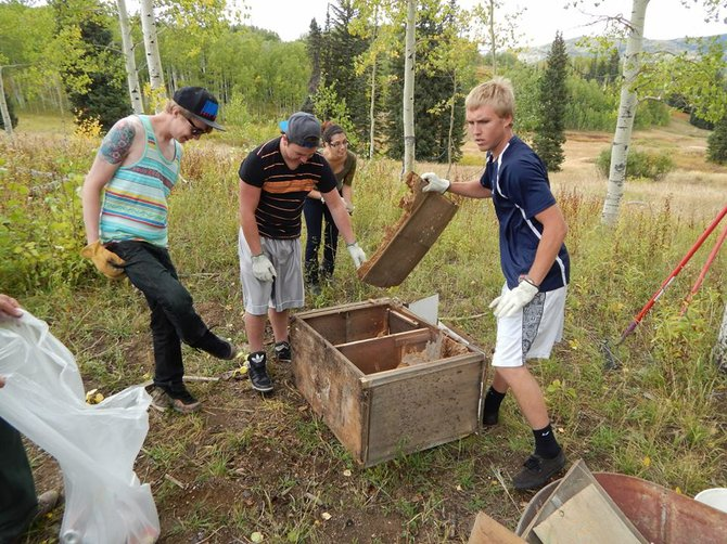 "Colorado Mountain College ""College 101"" students Hunter Hinson, from left, Colton Peters, Angelica Jajeh and Andrew Revak help remove a bullet-riddled cabinet from a campsite on Buffalo Pass last week. The class went in two groups of 10 to clean up campsites as part of a service project."