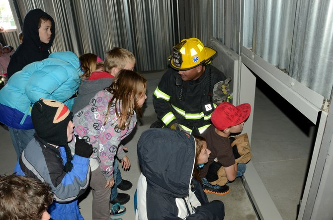 Shane Krause, of Craig Fire/Rescue, shows an attic simulation room in the new fire training tower during a tour Saturday. Craig Fire/Rescue celebrated the grand opening of the tower with food, tours and demonstrations.