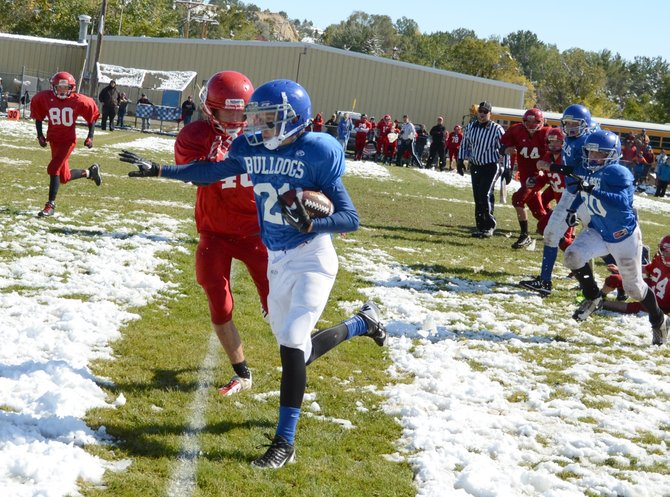 Kaden Hafey gets around a Steamboat defender on his way to a 45-yard touchdown run in the fourth quarter of Craig Middle School's eight-grade game vs. Steamboat on Saturday. Hafey's score tied the game, but the Bulldogs fell to the Sailors in overtime, 9-6.