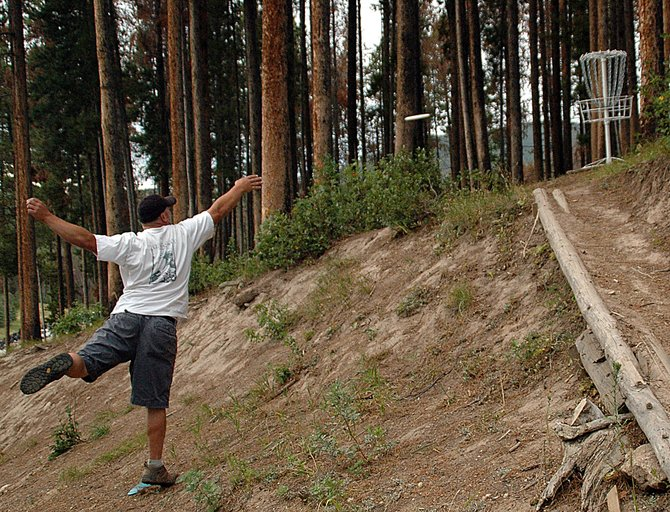 Jason Ruemelin tries to toss in a short putt in 2008 at the Thunderhead Disc Golf course at Steamboat Ski Area. The course was closed that year because of logging to remove beetle-killed trees. Disc golf proponents are working to open the course again as soon as next summer.