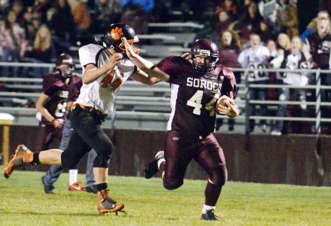 Soroco's Ian Palyo holds off Hayden's Journey Vreeman late in the Rams' 26-6 win against the Tigers on Sept. 20. This week, Soroco faces Rangely, a team that narrowly defeated Hayden, 15-14, earlier this season.