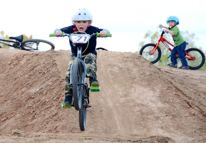 Jett Nemec, 5, flies over a jump at the new Bear River Bike Park jump lines in Steamboat Springs as younger brother Cael Nemec watches. The brothers weren't afraid to tackle the jumps, which recently were completed as part of the Bell Built grant project.