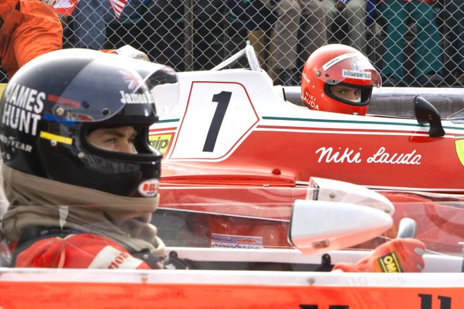 "Racers James Hunt (Chris Hemsworth) and Niki Lauda (Daniel Brühl) await the checkered flag in ""Rush."" The movie is about the rivalry between the two Formula One drivers in the 1970s."