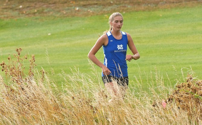 Moffat County High School senior Brenna Ciesco holds a steady lead in the girls' 5k event in the Rifle Invitational cross-country meet at Rifle Creek Golf Course on Thursday.