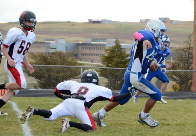 Hugo Hernandez breaks away from a Steamboat tackler Tuesday at the Bulldog Proving Grounds. The Moffat County C team beat Steamboat, 38-0, and is now 7-1 this season.