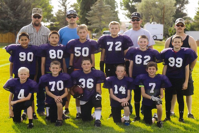 The Ravens were champions in this year's Craig Parks and Recreation fifth/sixth grade football league, winning 7-6 over the Hayden Tigers Wednesday. Front row, from left: Christopher Maneotis, Blake Juergens, Bryan Gonzales, Donnie Quick, Tyler Fortune. Second row, from left: Jesus Paez, Huvel Mendoza, Beau Hellander, Danial Caddy, Joe Campagna. Coaches, from left: Kirk Hellander, Marco Cuevas, Jason Juergens, Jarrot Caddy.