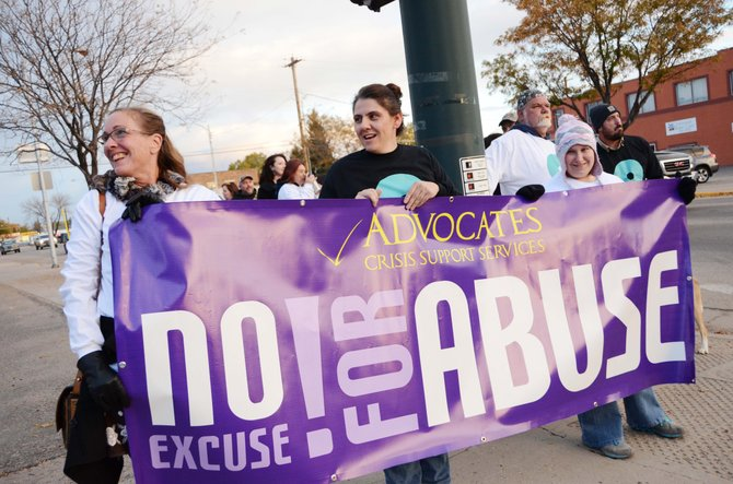About 20 people marched from City Park to Moffat County Courthouse to raise awareness about about domestic violence in a walk led by Advocates Crisis Support Services.